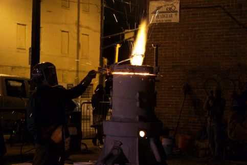 A firearm is melted over a furnace in a guns-to-shovels ceremony last week in Atlanta.