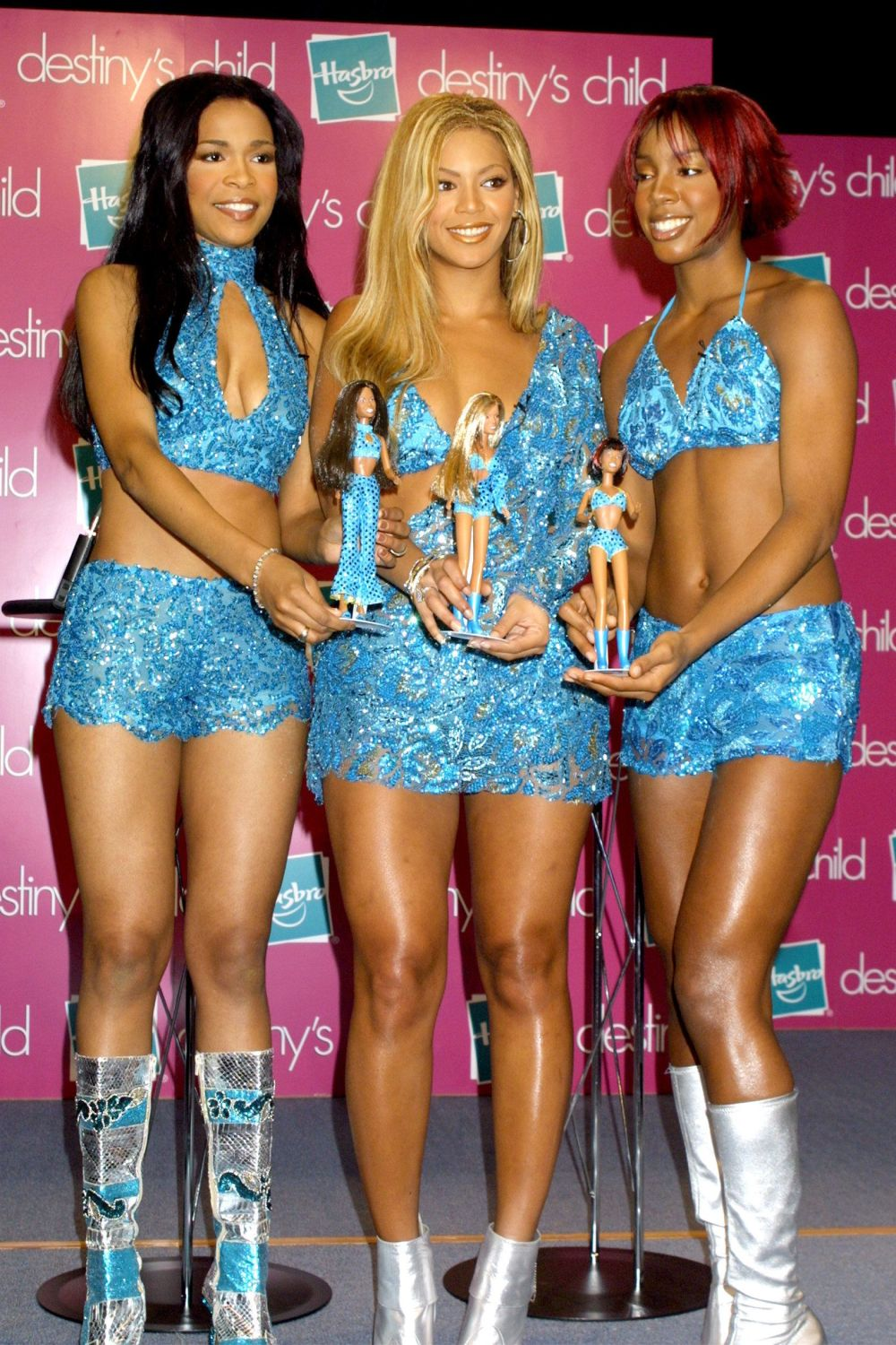 Williams, Knowles and Rowland posing for a photograph with their Destiny's Child dolls from Hasbro Inc. in New York City.