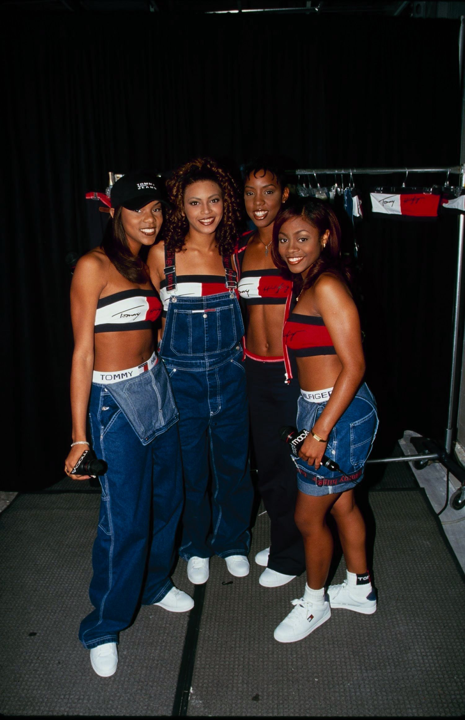 Luckett, Knowles, Rowland and Roberson at a Macy's event wearing matching Tommy Hilfiger ensembles.