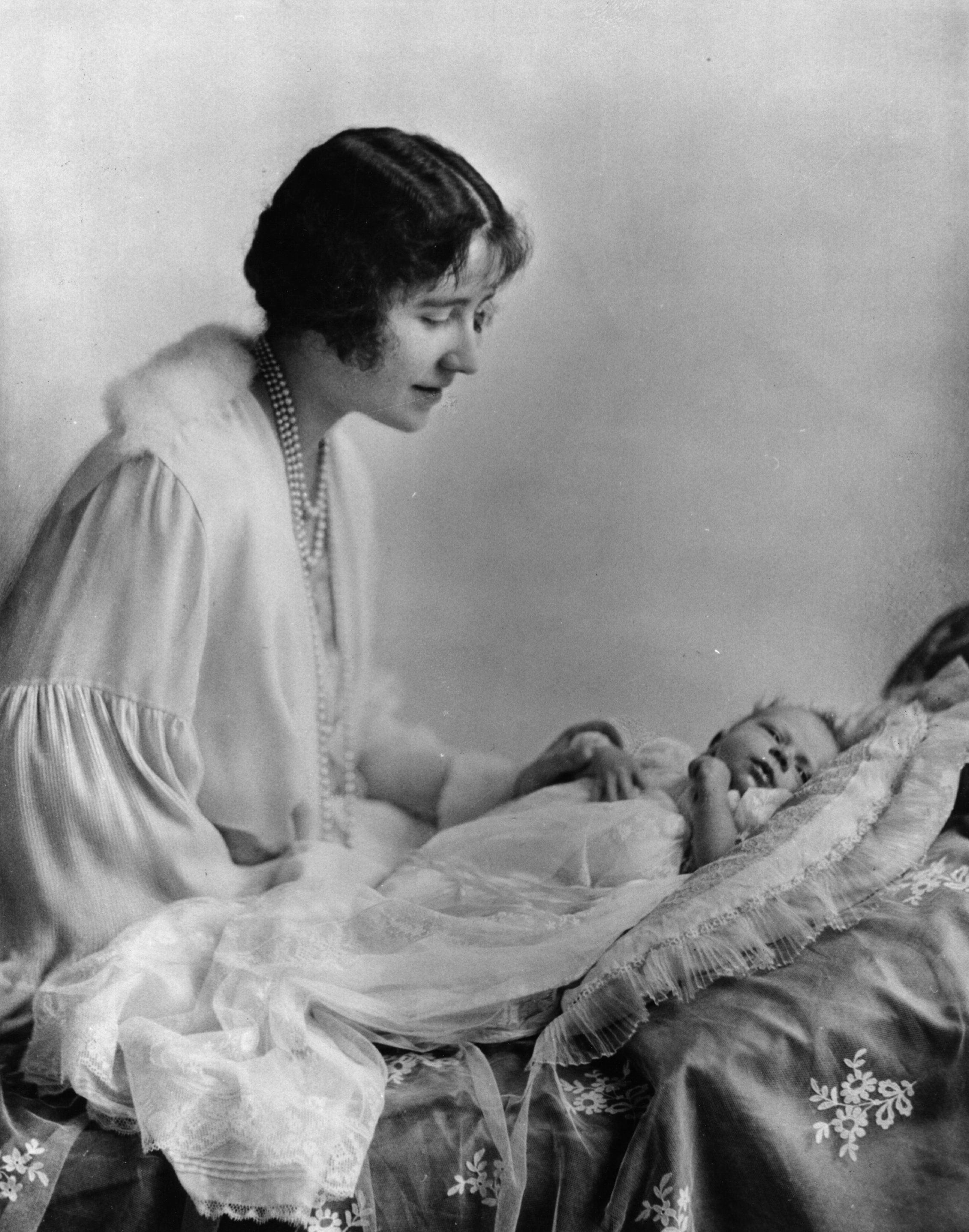 On April 21, 1926, Queen Elizabeth II (then Princess Elizabeth) was born. In this photo, she shares a loving moment with her