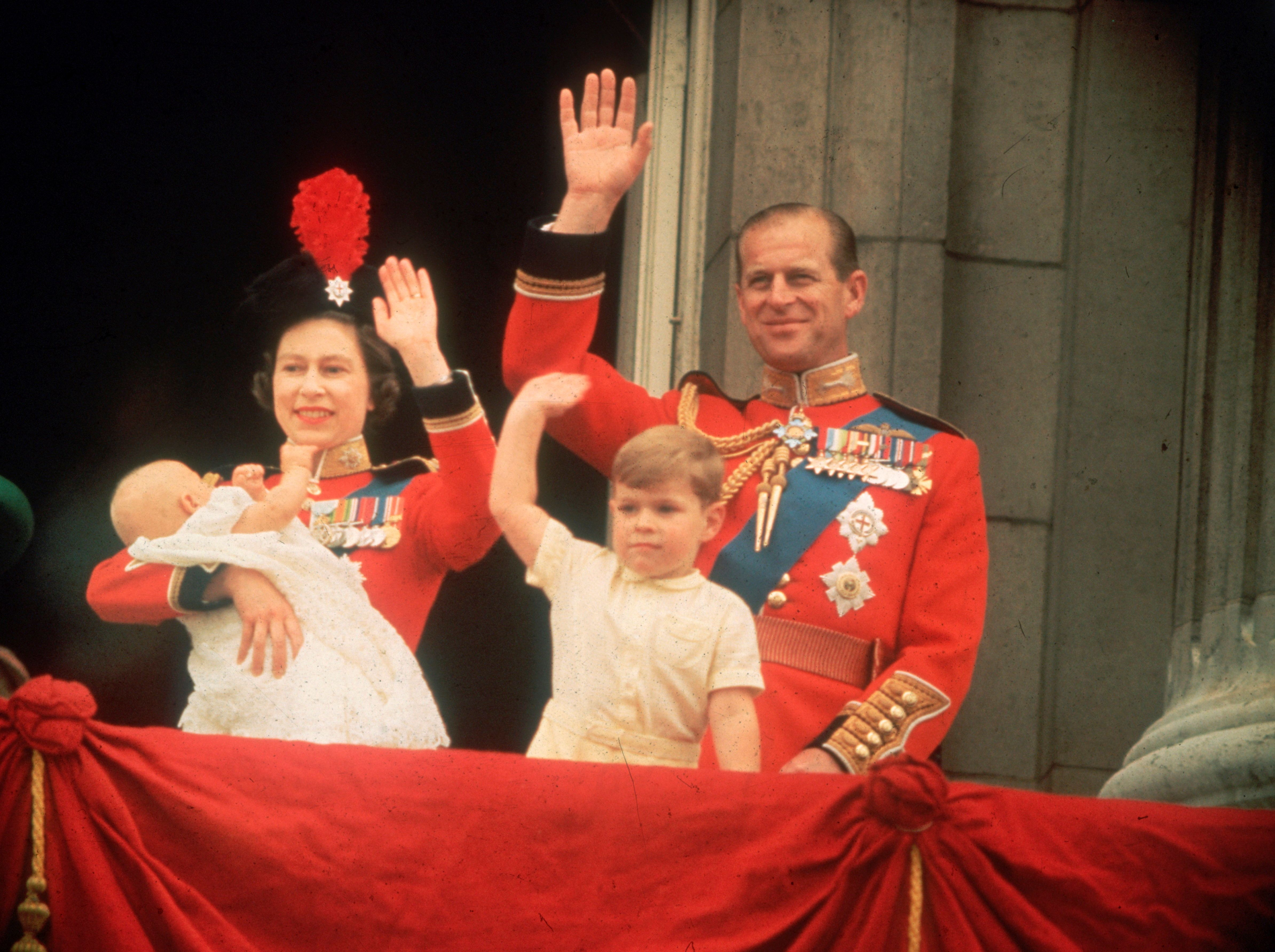 Elizabeth expanded her family once again when she welcomed Prince Edward (in the queen's arms on the left) in 1964. This phot