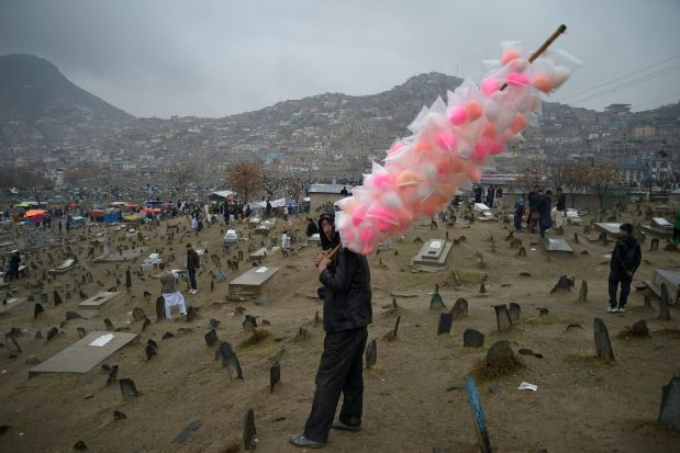 A vendor sells candy floss in Kabul on March 21, 2017, during Nowruz festivities that mark the Afghan New Year.