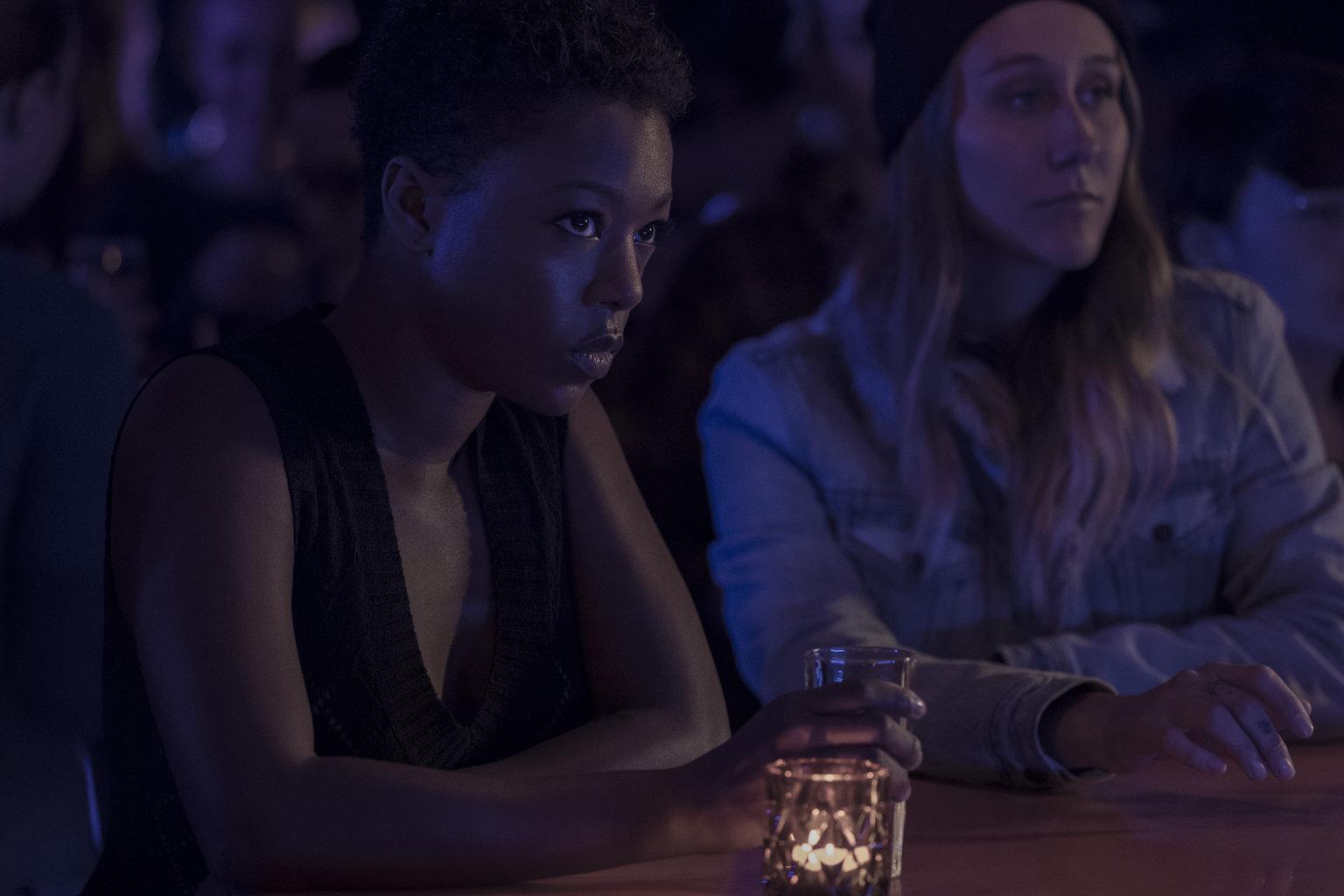 Moira (left, Samira Wiley) at a lesbian bar in Canada.