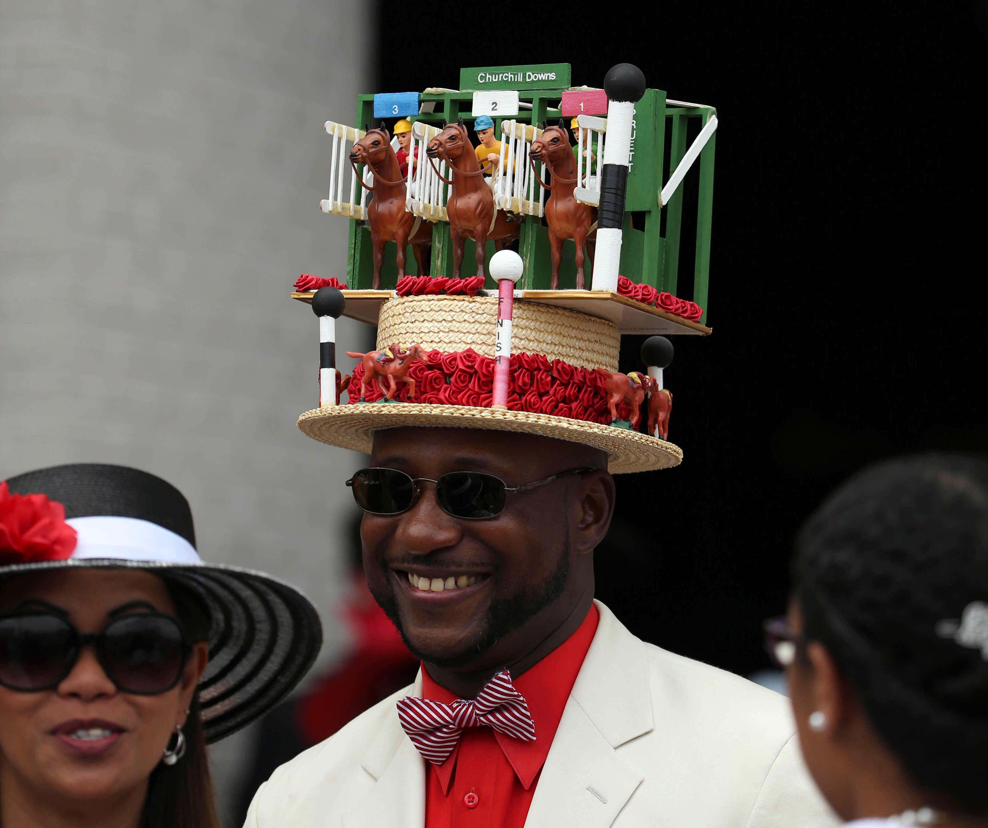 A patron wears a decorated derby hat before the derby in 2016.