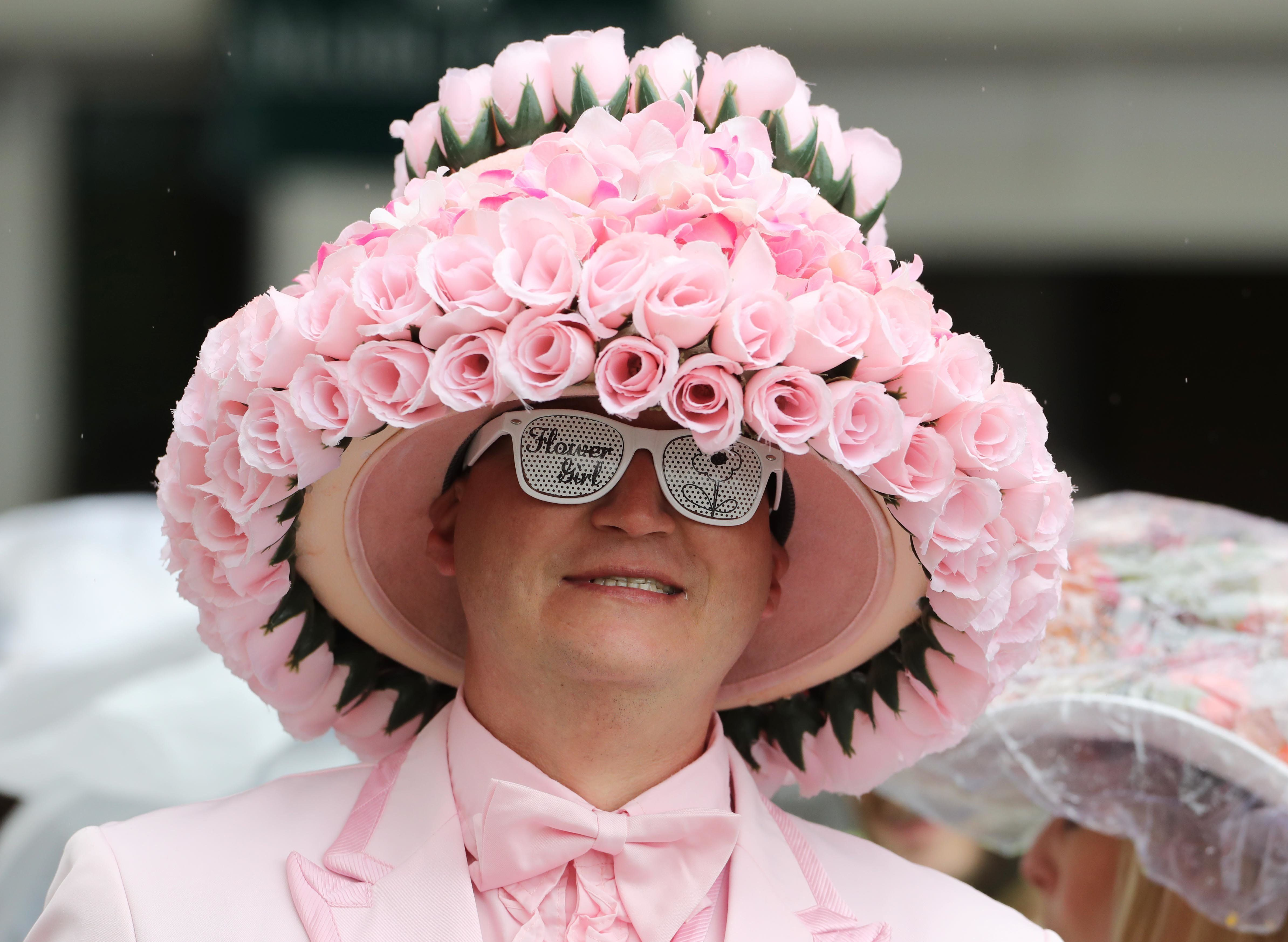 A patron wears a derby hat at the 2017 Kentucky Oaks race, which takes place at Churchill Downs the day before the Kentu