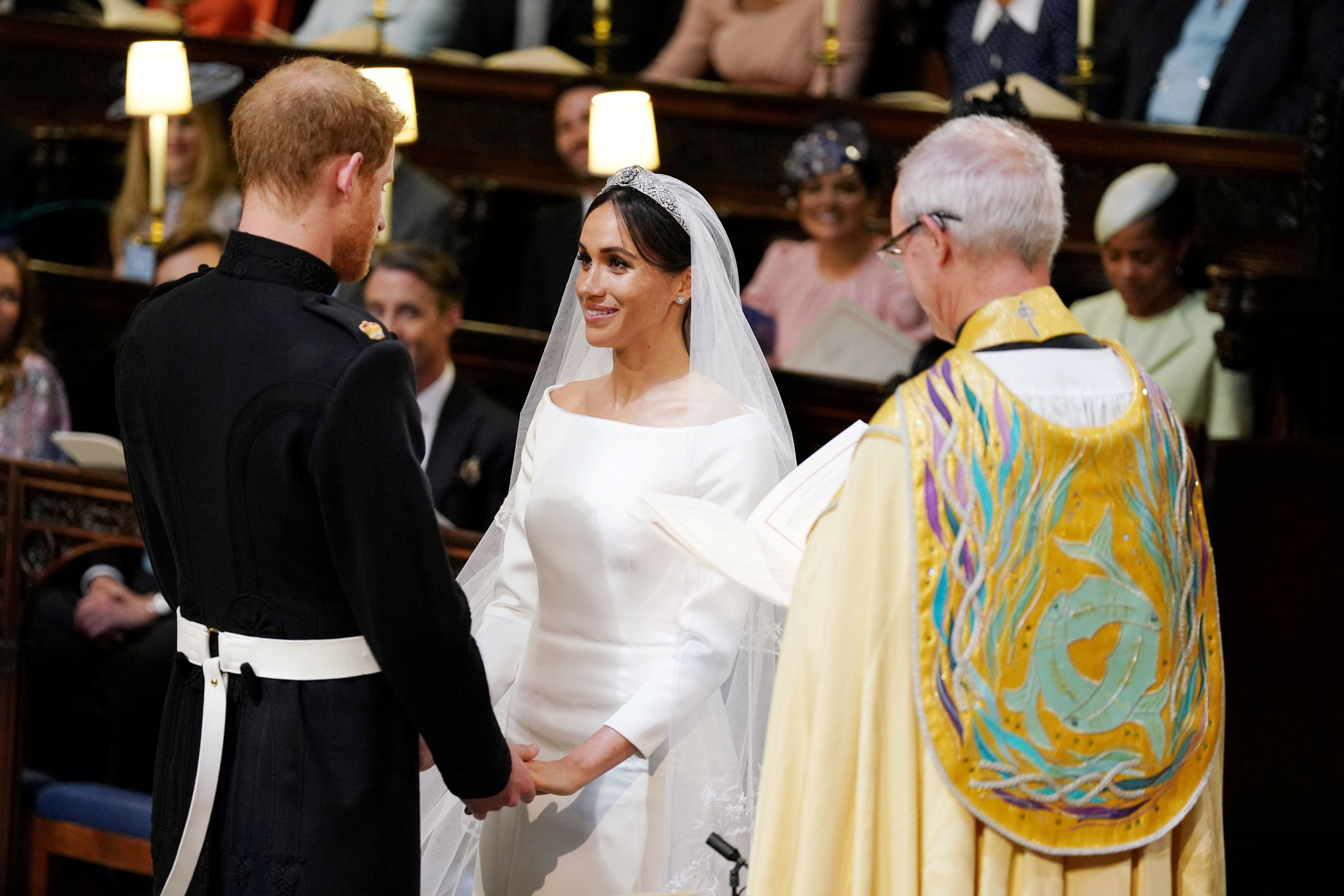 Prince Harry and Meghan Markle in St George's Chapel at Windsor Castle during their wedding service, conducted by the Archbis