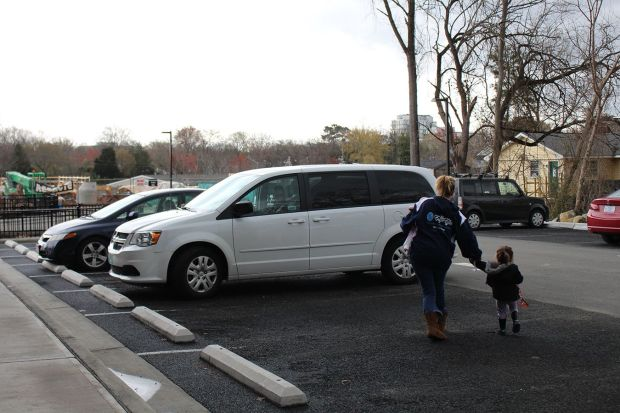 A white van drives mothers and their children to the treatment center each day from the residential apartments, where staff