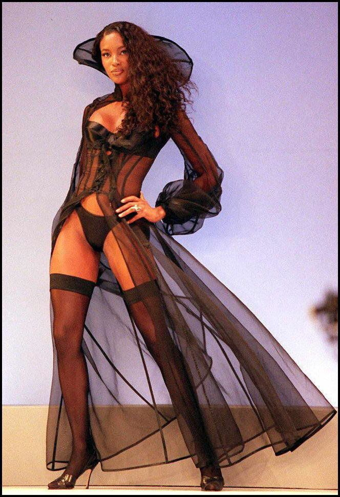 Wearing a black satin bra and panty set and robe during the Victoria's Secret show in New York.