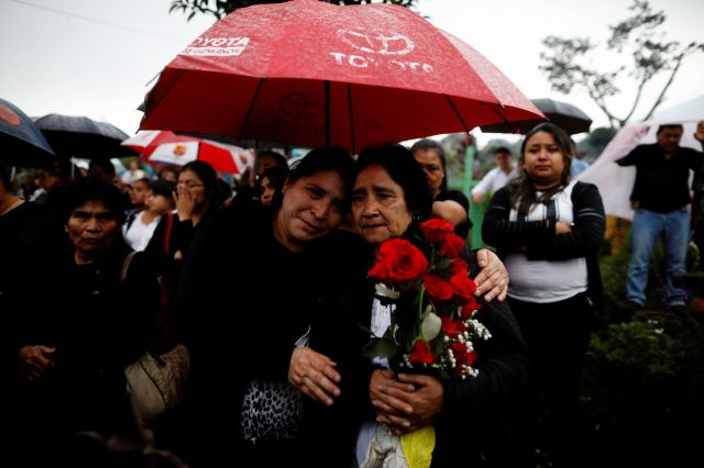 Mourners and relatives participate in the funeral of Juan Fernando Galindo, member of the National Coordinator for Disasters