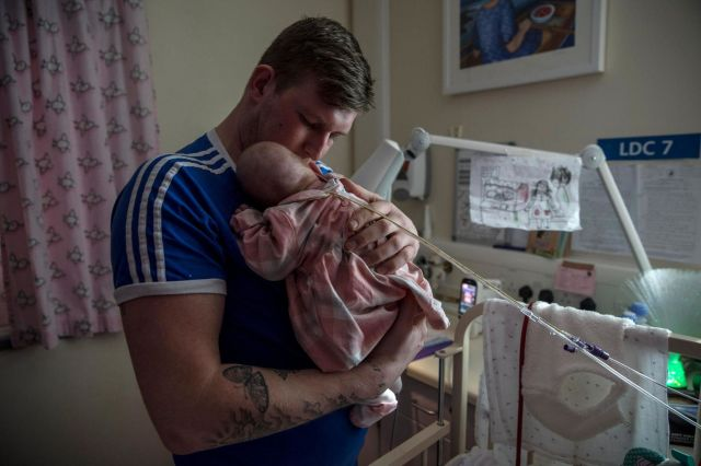 Jordan Bagshaw holds his 49-week-old daughter Marley Rae Bagshaw, who was born prematurely, in the neonatal unit of the Royal
