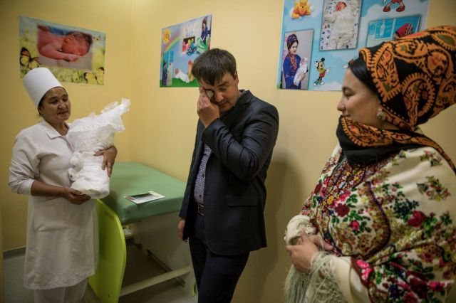 On March 30, father Shageldi and mother Ogulhally look at their baby boy Nepes, born on March 27 at the maternity u