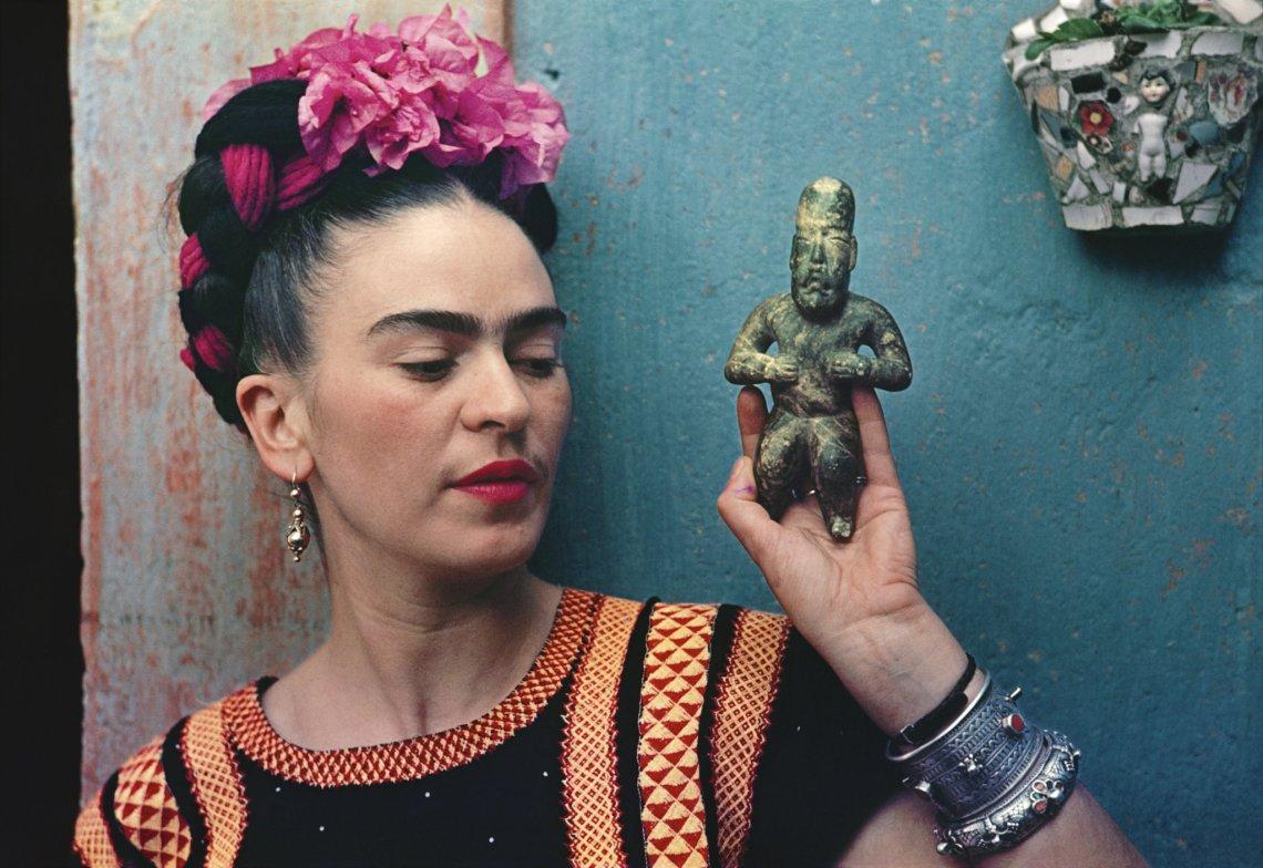 Frida Kahlo with Olmec figurine, 1939.