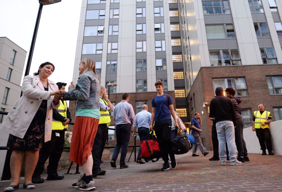 Residents leave the Taplow tower block on the Chalcots Estate in Camden, London, as the building is evacuated in the wake of the Grenfell Tower fire.