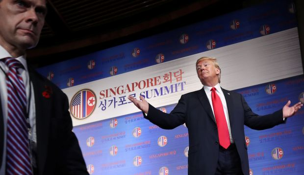 President Donald Trump speaks at a news conference after his meeting with Kim Jong Un in Singapore on Tuesday.