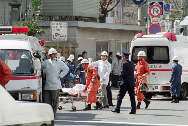 This picture taken on March 20, 1995, shows a victim on a stretcher being moved to an ambulance at Tsukiji subway station fol