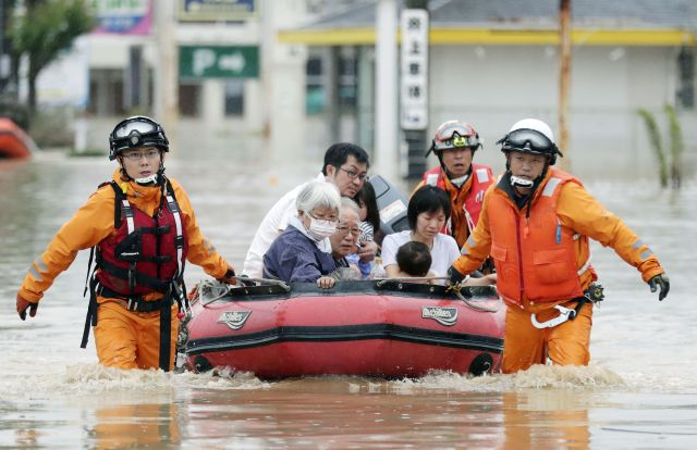 Local residents rescued from a flooded area in Kurashiki on July 8, 2018.