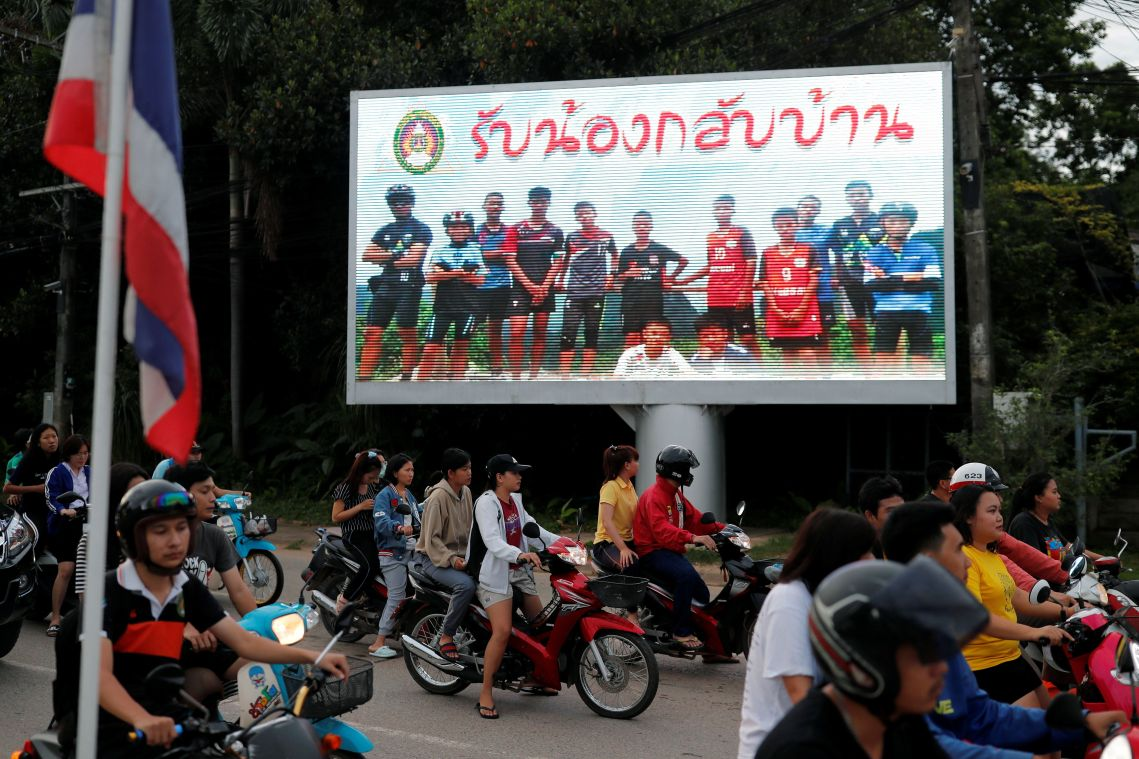 A board showing 'Welcome home, boys' on display in Thailand where rescuers today hope to free the remaining four boys and their coach