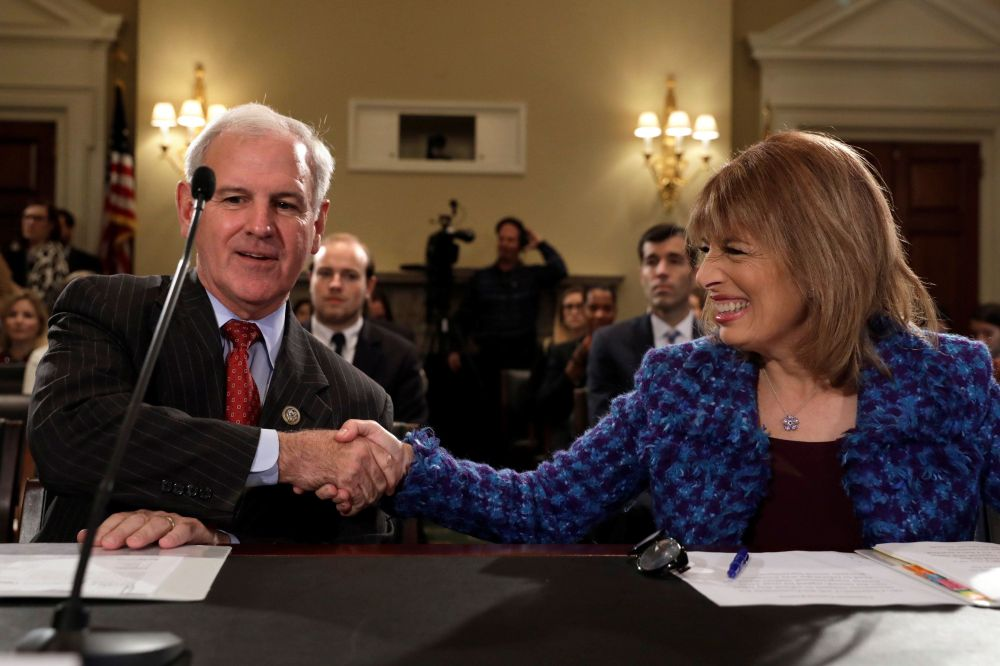 Reps. Bradley Byrne (R-Ala.) and Jackie Speier (D-Calif.), two of the most unlikely allies, shake hands before laying out the
