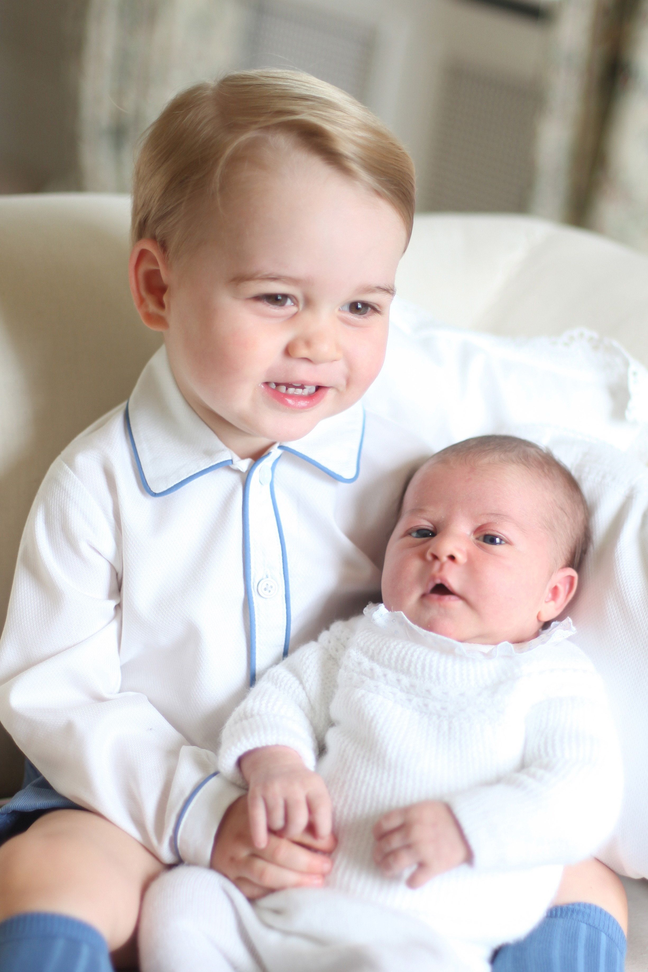 Prince George and Princess Charlottein a photo taken by the Duchess of Cambridge in mid-May 2015 at Anmer Hall in Norfo