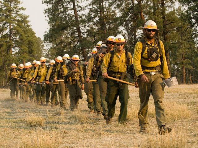 Wildland firefighters, like this crew heading into New Mexico's Gila National Forest, in 2012, are equipped and operate diffe