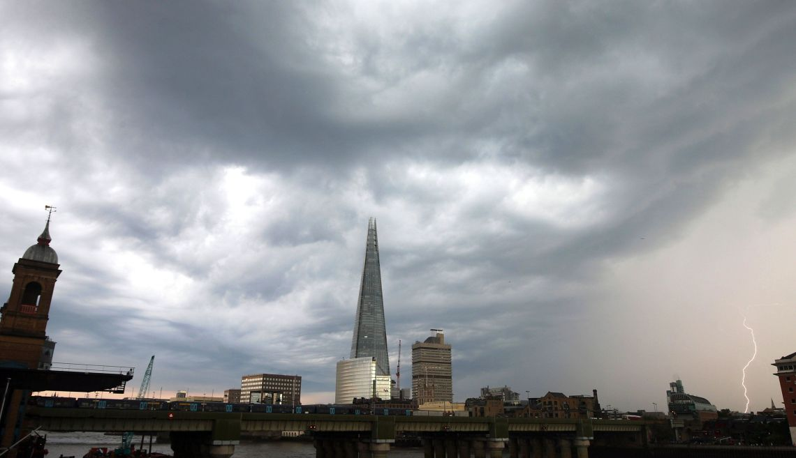 Lightning strikes near The Shard in London on Friday as torrential rain continues on Saturday.