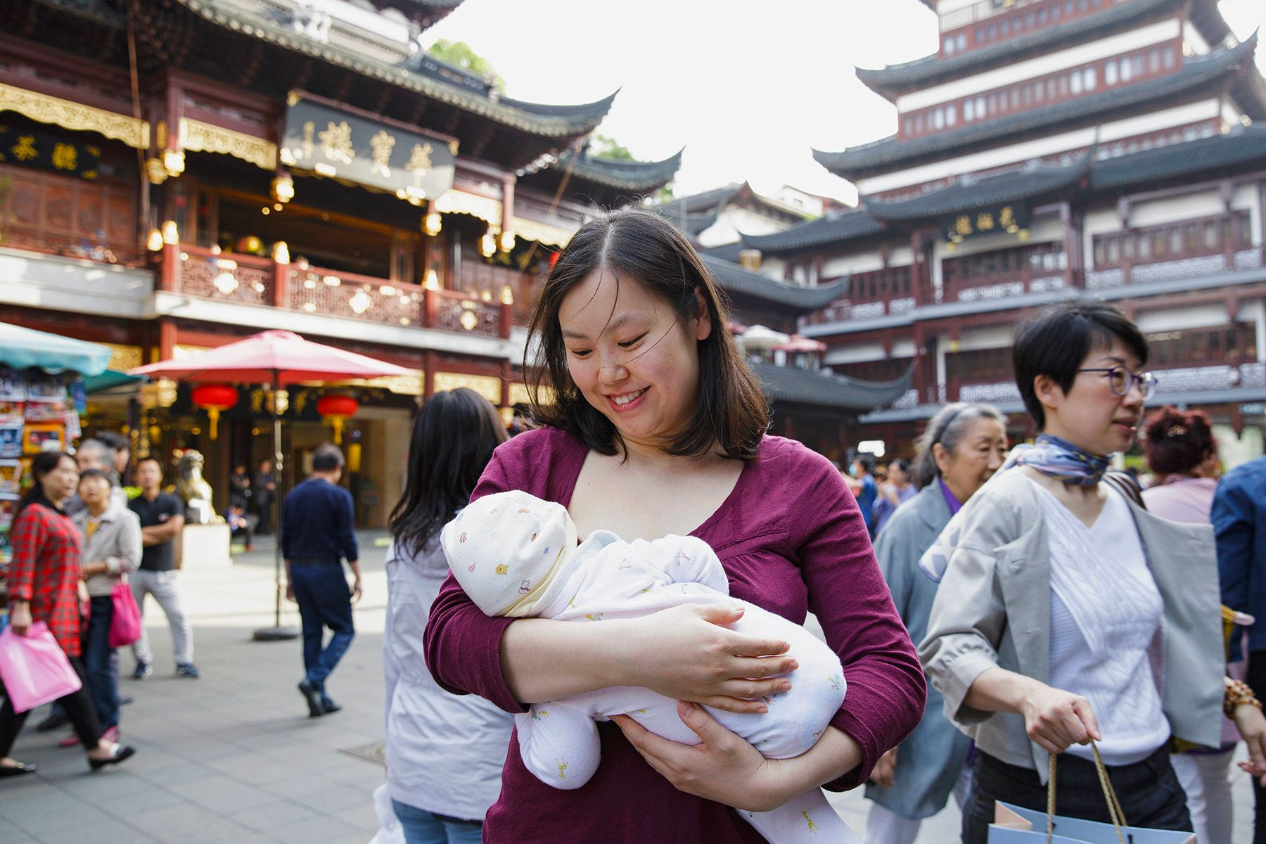 Tanxian, a Chinese mother,nurses her baby in Shanghai.
