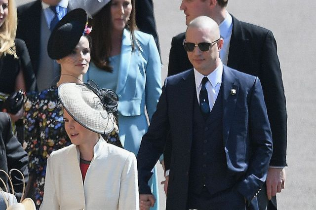 Tom Hardy and his wife attend the wedding of Prince Harry and Meghan Markle on May 19 in Windsor, England.