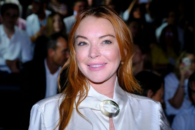 Lindsay Lohan, shown here at Madrid Fashion Week in 2017, said women should file a police report and speak about sexual misco