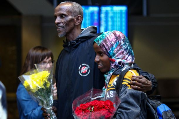 Somane Liban greets his granddaughter Dahaba Matan, a refugee from Somalia, who arrived at the airport in Boise, Idaho, on Ma