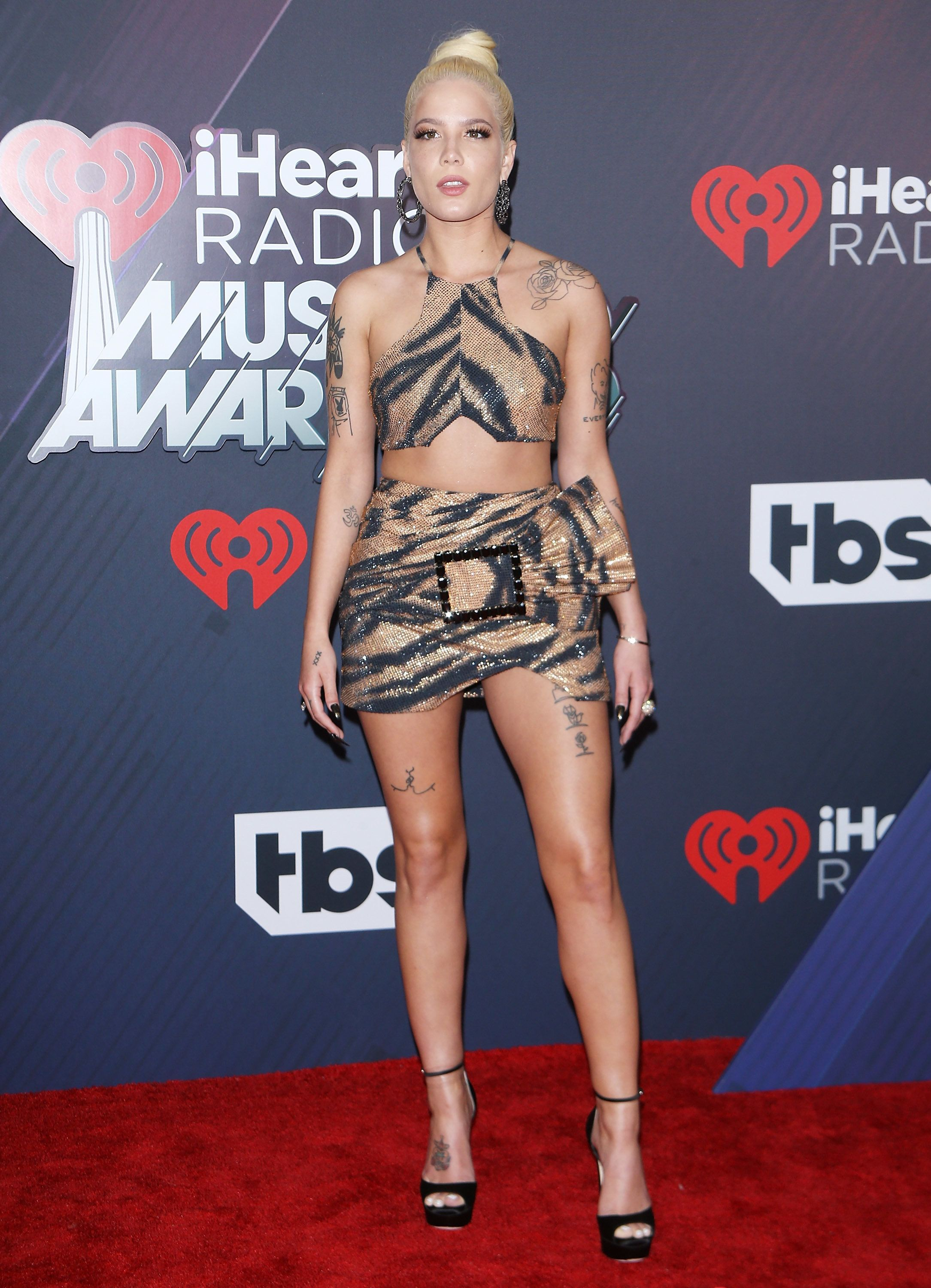 Wearing an animal-print Raisa & Vanessa outfit at the iHeartRadio Music Awards on March 11 in Inglewood, California.