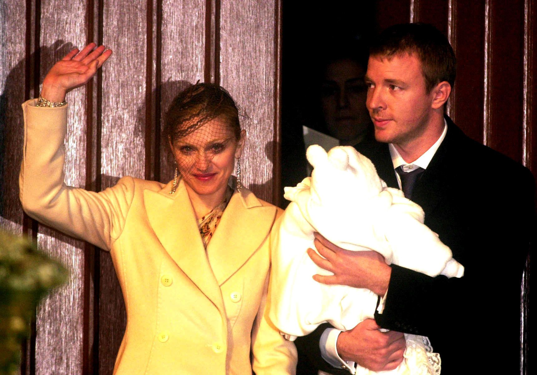 "Madonna <a href=""https://people.com/premium/madonnas-wedding-story/"" target=""_blank"">married</a> British film director Guy Ri"
