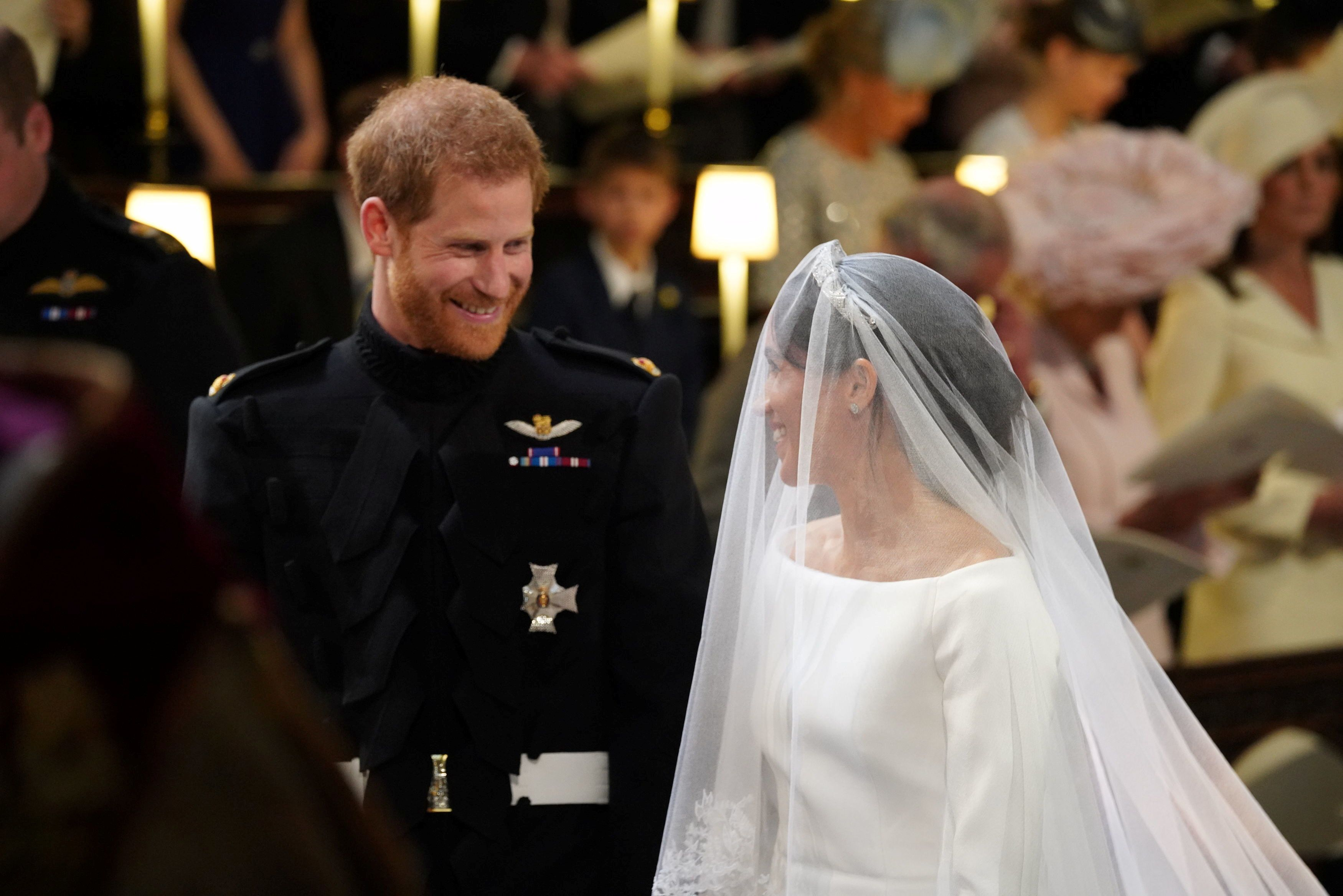 Prince Harry and Meghan Markle at their wedding at St. George's Chapel at Windsor Castle on May 19, 2018.