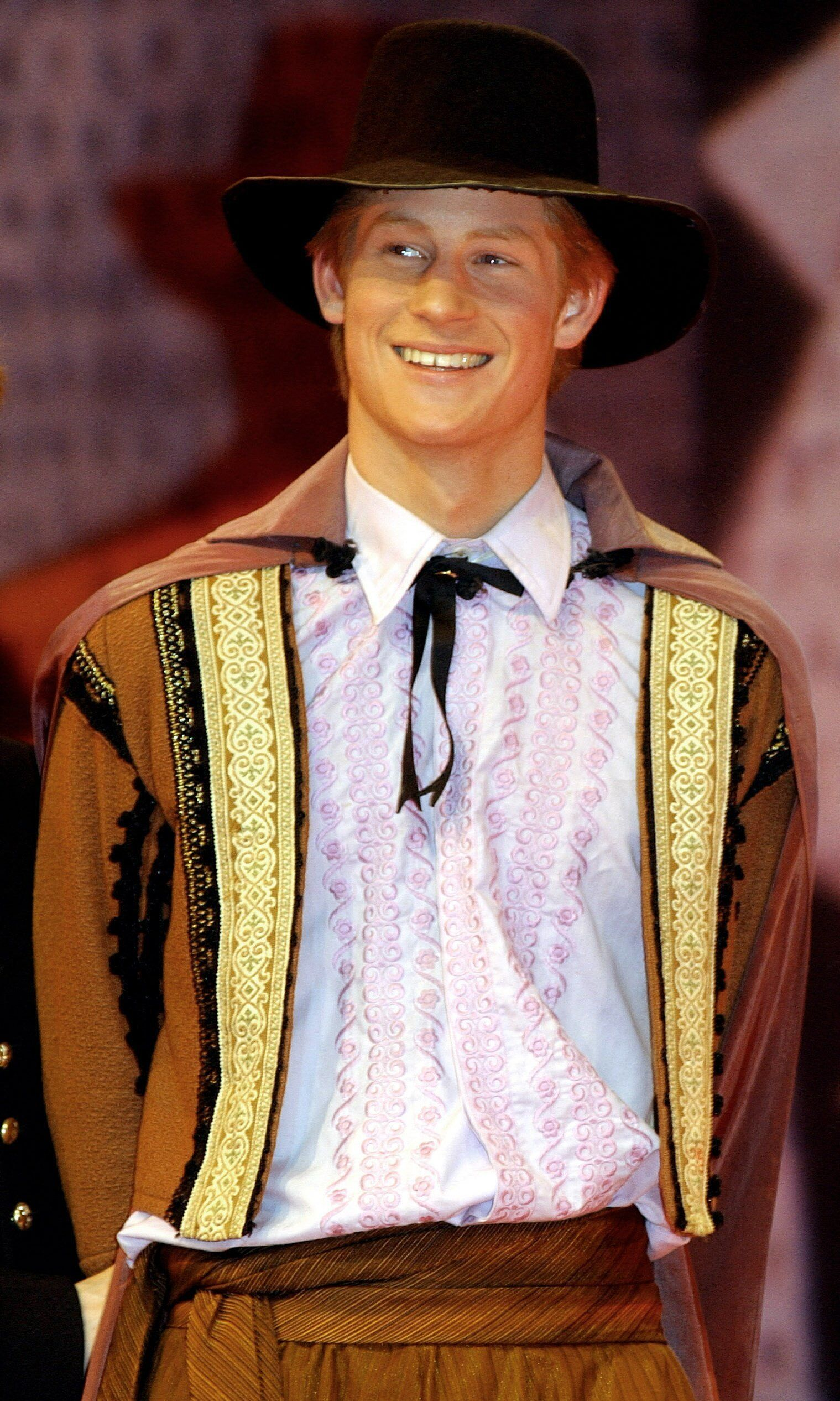 """Prince Harry acts in a masked ball scene in a production of """"Much Ado About Nothing"""" at Eton College in March 2003."""