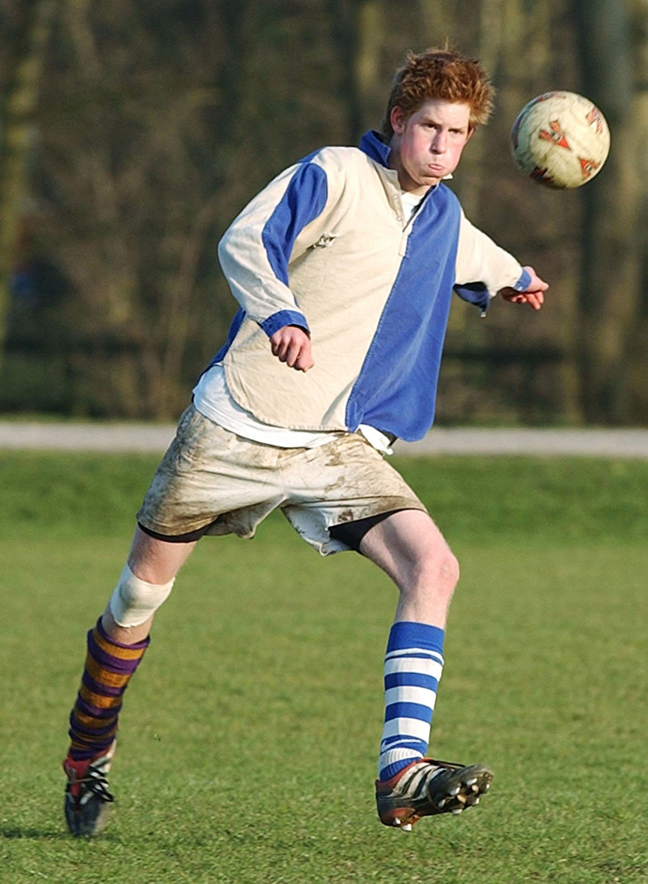 "Prince Harry takes part in the field game against a team of ""Old Boys"" in March 2003 at Eton."