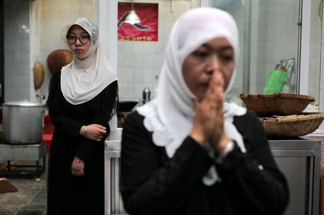 Women stand at a kitchen near a mosque during the Muslim holiday Eid al-Adha, in Kunming, Yunnan province, China August 22, 2