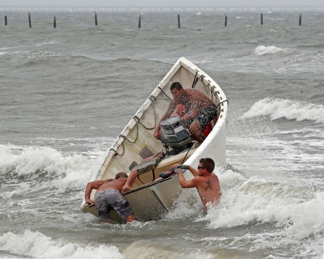 Fishermen attempt to recover their haul-seine fishing net as Hurricane Florence approaches Virginia Beach, Virginia, on Sept.