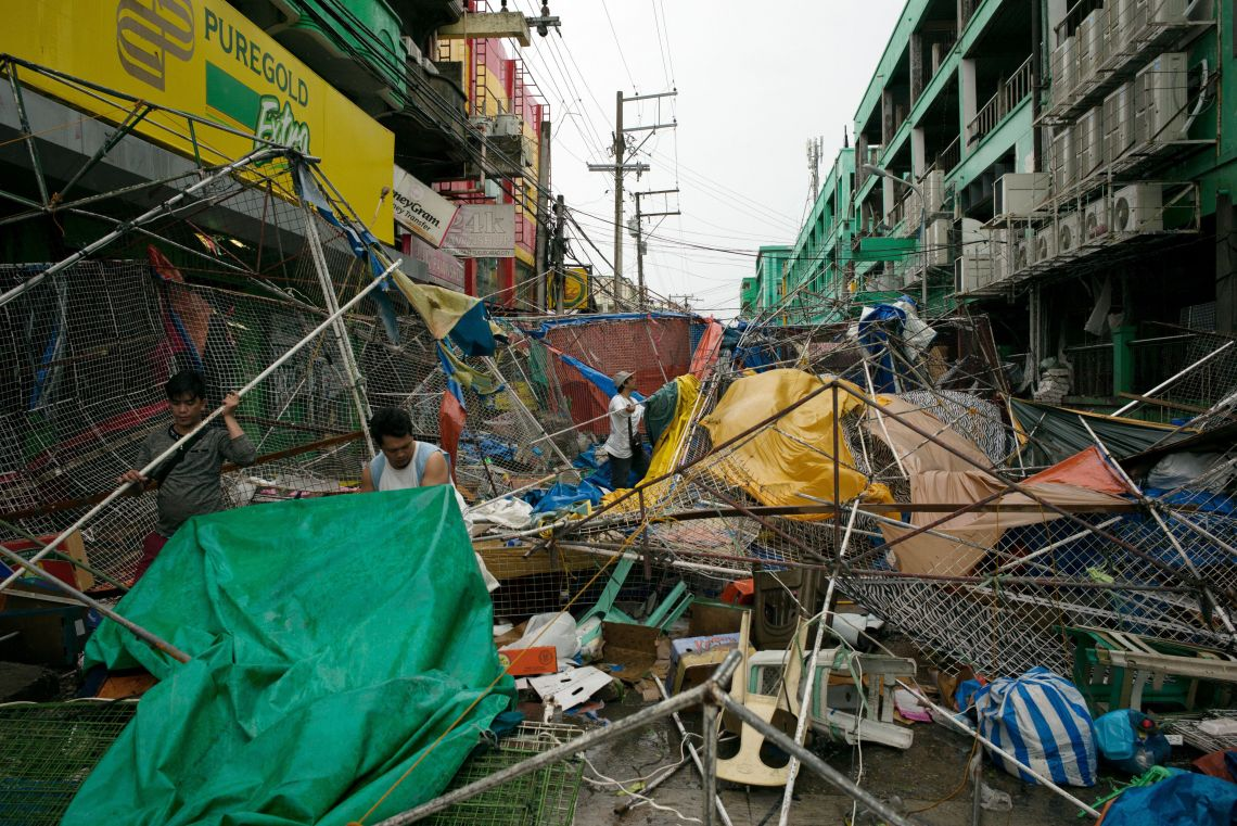 People clear the wreckage and debris of street stalls at a bazaar after Typhoon Mangkhut hit in Tuguegarao, Cagayan province, in the Philippines