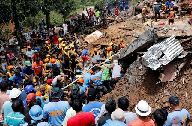Rescuers search for people trapped in a landslide caused by Typhoon Mangkhut in Itogon, Philippines, on September 17, 2018.&n