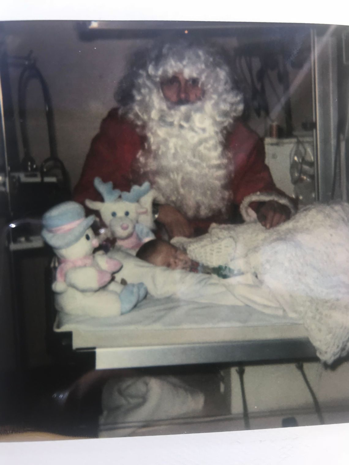 Baby Leah Aldridge being visited by Father Christmas in hospital