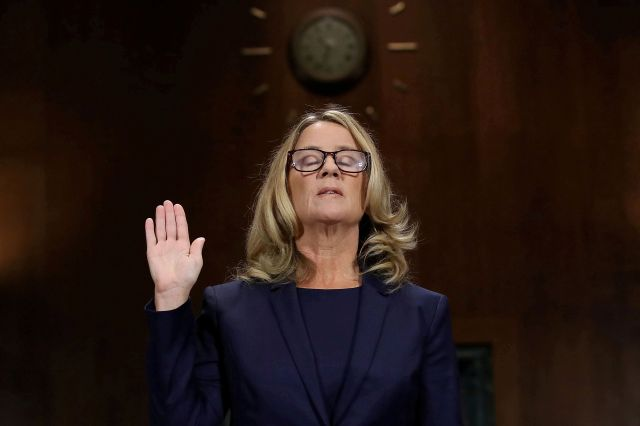 Dr. Christine Blasey Ford is sworn in prior to testifying before the Senate Judiciary Committee on Sept. 27, 2018.