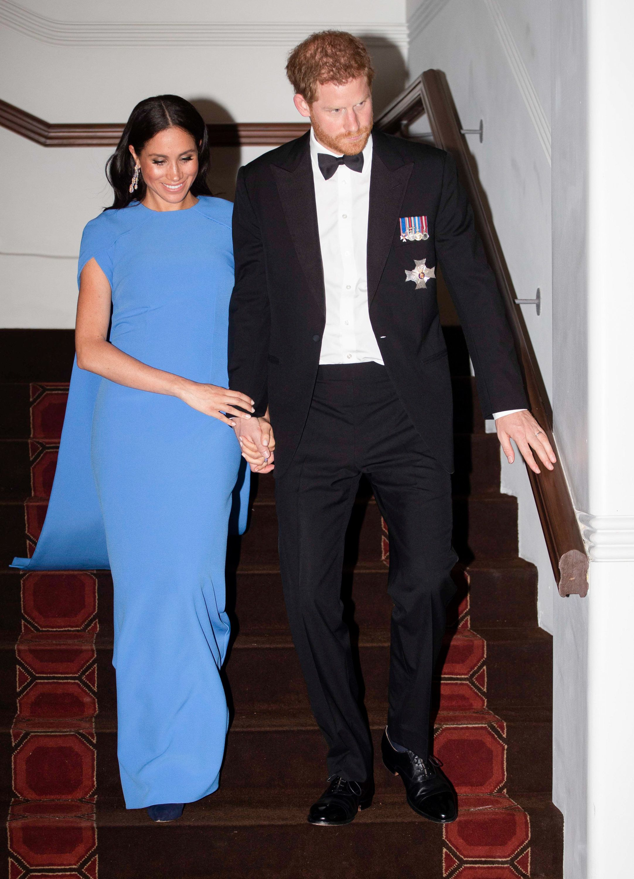 Prince Harry and Meghan, Duchess of Sussex attend a state dinner hosted by the president of the South Pacific nation Jioji Ko