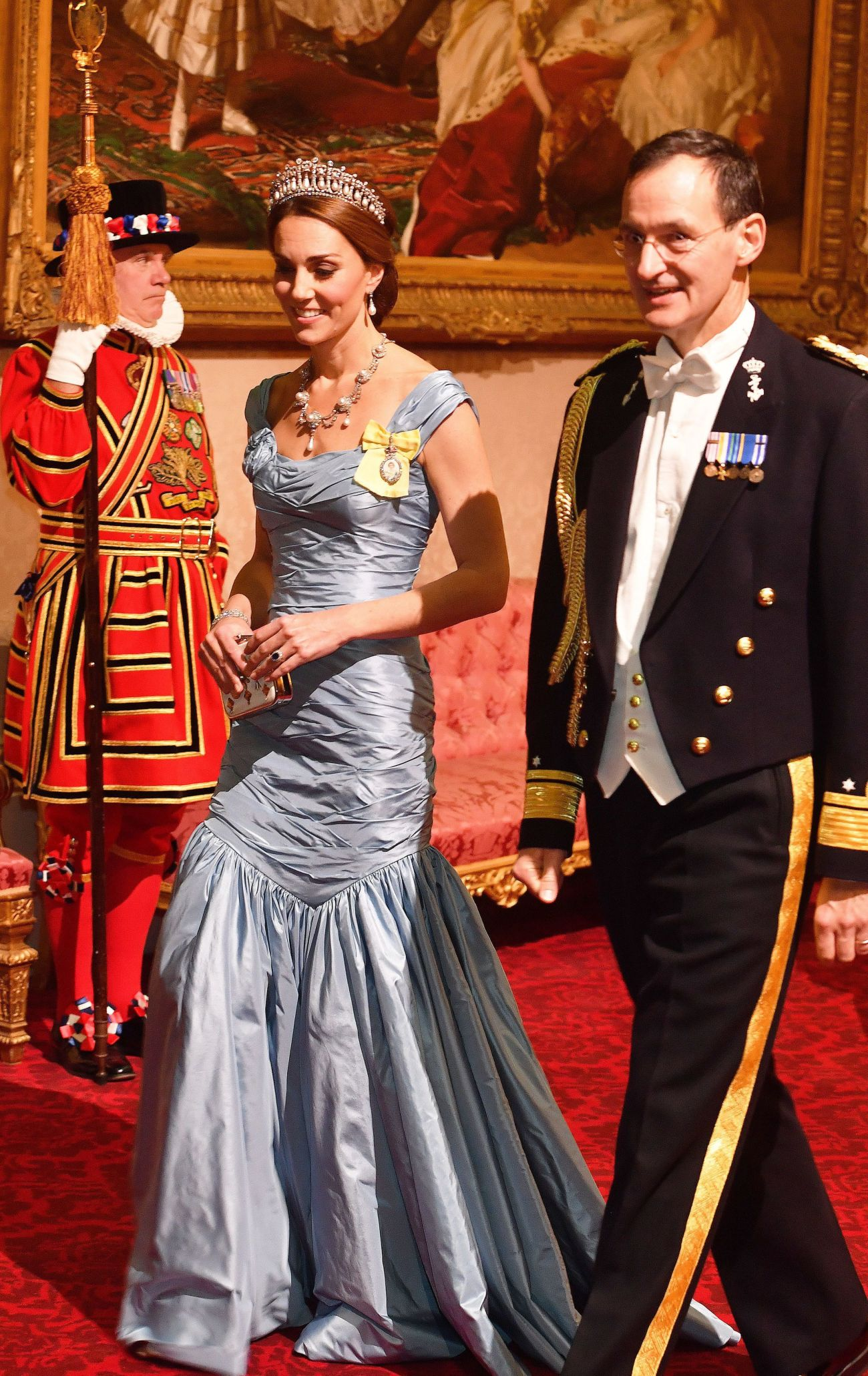 Kate walks with Rear Adm. Ludger Brummelaar at a state banquet in honor of King Willem-Alexander and Queen Maxima of the