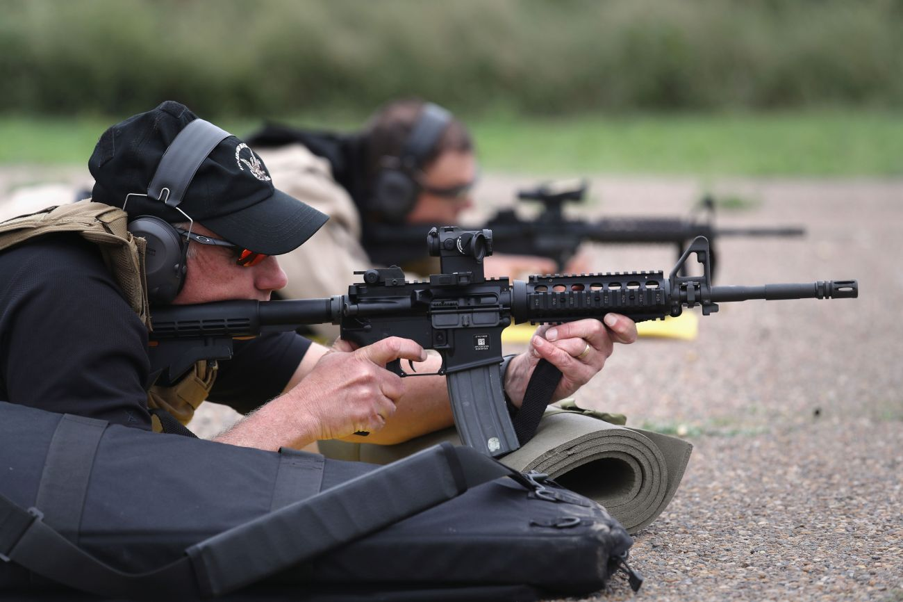 Customs and Border Protection agents fire M4 rifles during a qualification test at a shooting range on Feb. 22 in Hidalgo, Te