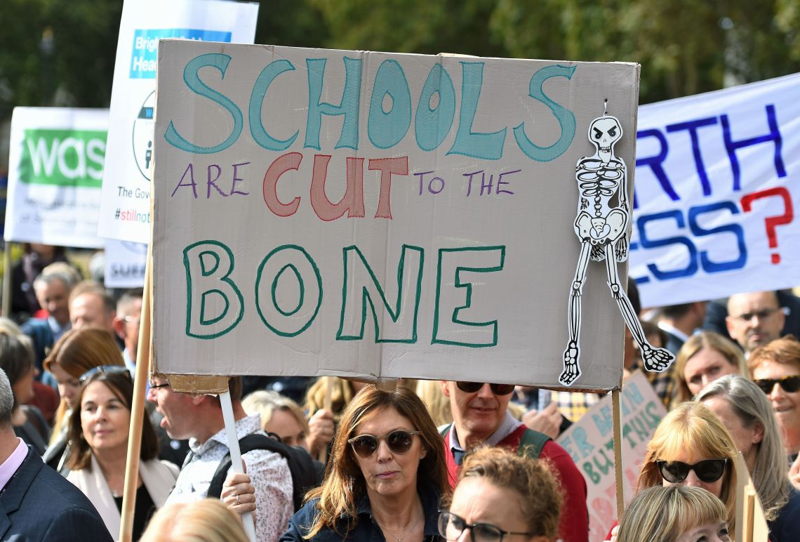 Headteachers marching in Parliament Square against budget cuts
