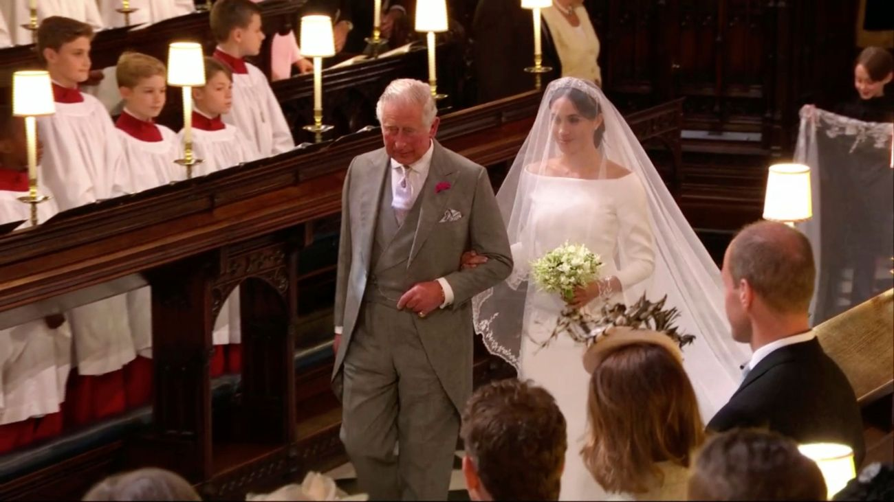 Meghan Markle walks down the aisle with Prince Charles for her wedding ceremony at St. George's Chapel in Windsor Castle in W
