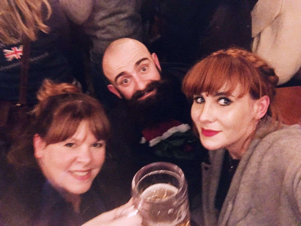 Alexa (right) with friends at a Christmas market.