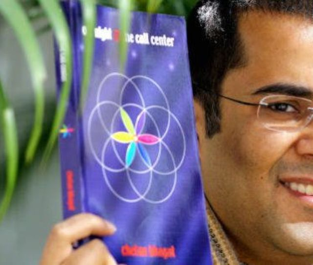 Samantha Sin Via Getty Images Hong Kong China Investment Banker Chetan Bhagat Poses With His Novel In Hong Kong