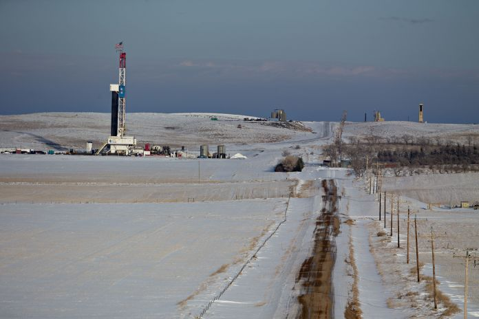 An American flag flies on top of a Unit Drilling Co. rig in the Bakken Formation outside Watford City, North Dakota.