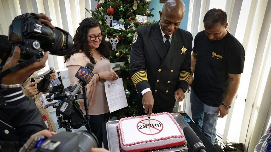 Sheriff Garry McFadden of Mecklenburg County, North Carolina, celebrates his election in November by slicing a cake frosted w