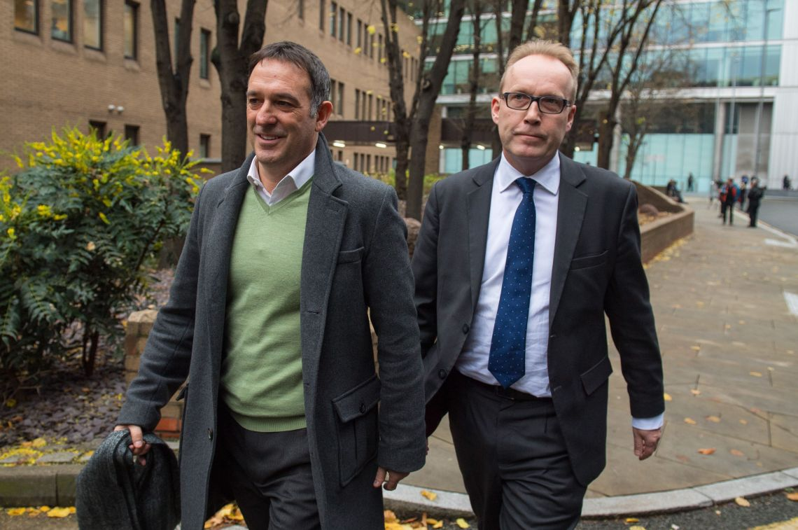 Former Tesco UK managing director Chris Bush (left) leaves Southwark Crown Court, in London, after being acquitted of charges of fraud and false accounting.